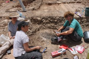 Sue Adi and Liora excavating pit in Area D