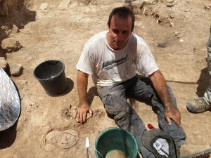 Yoav excavating bunch of bowls
